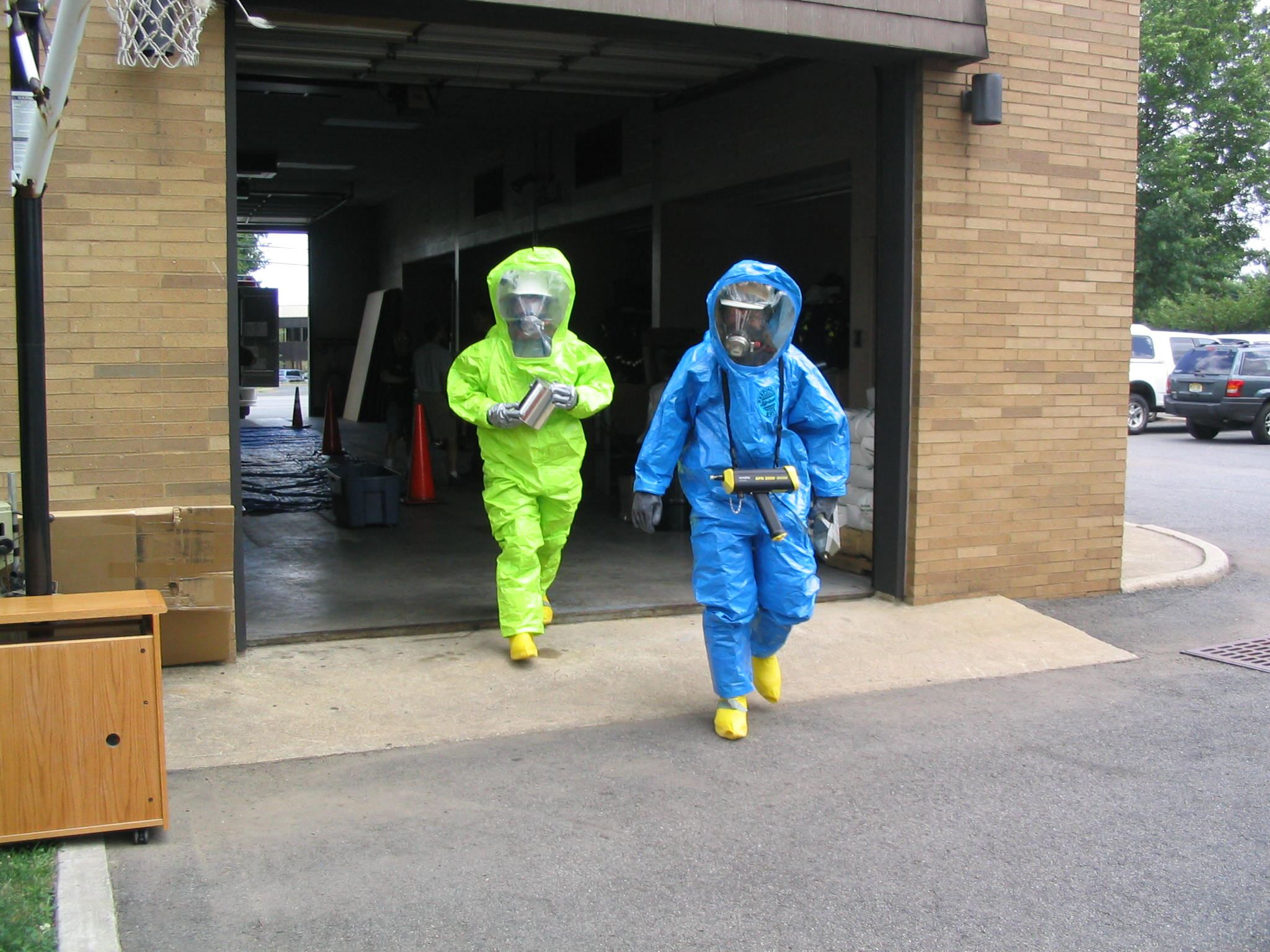 Two Hazmat People Walking