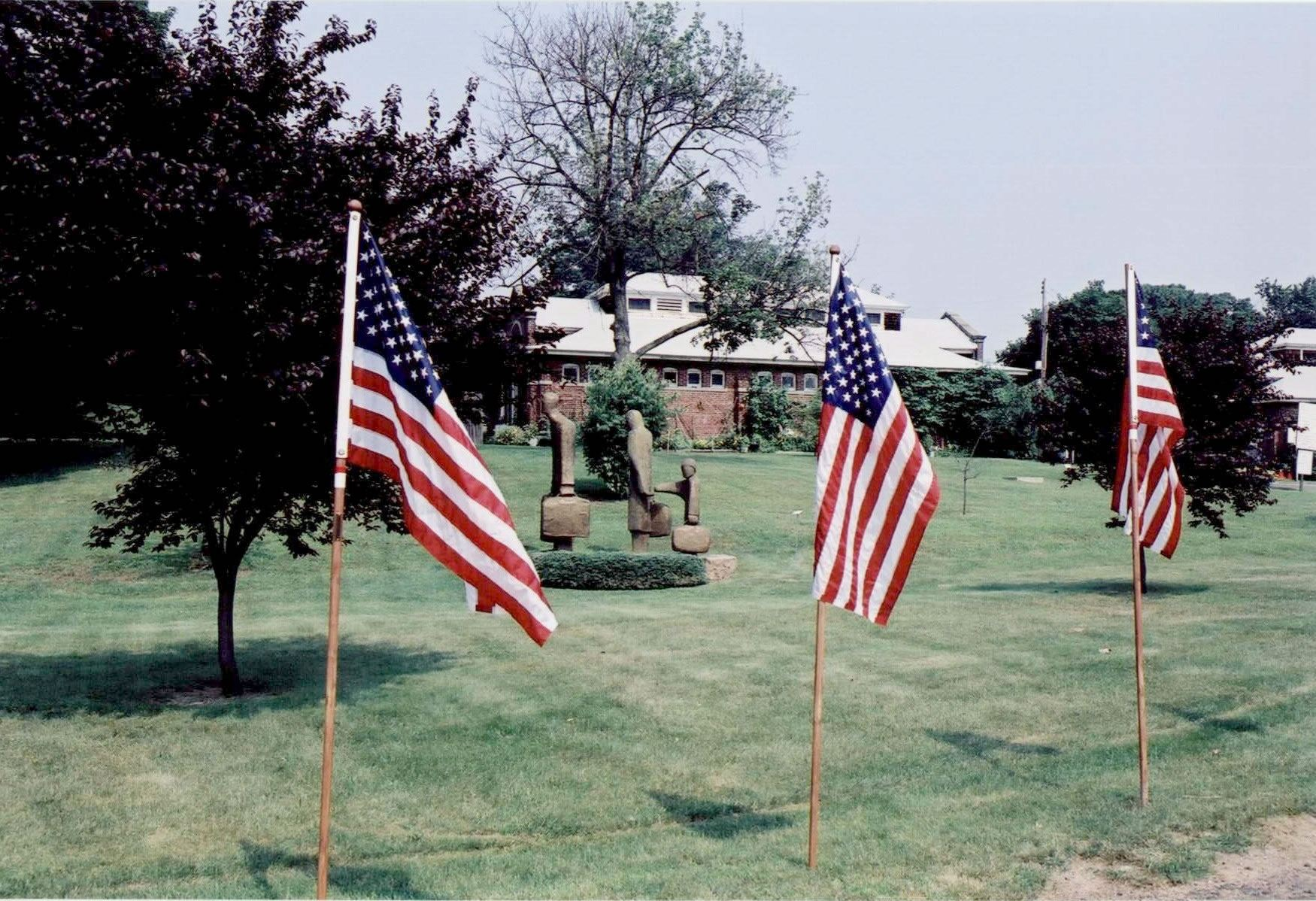 Flags set up in front of statue