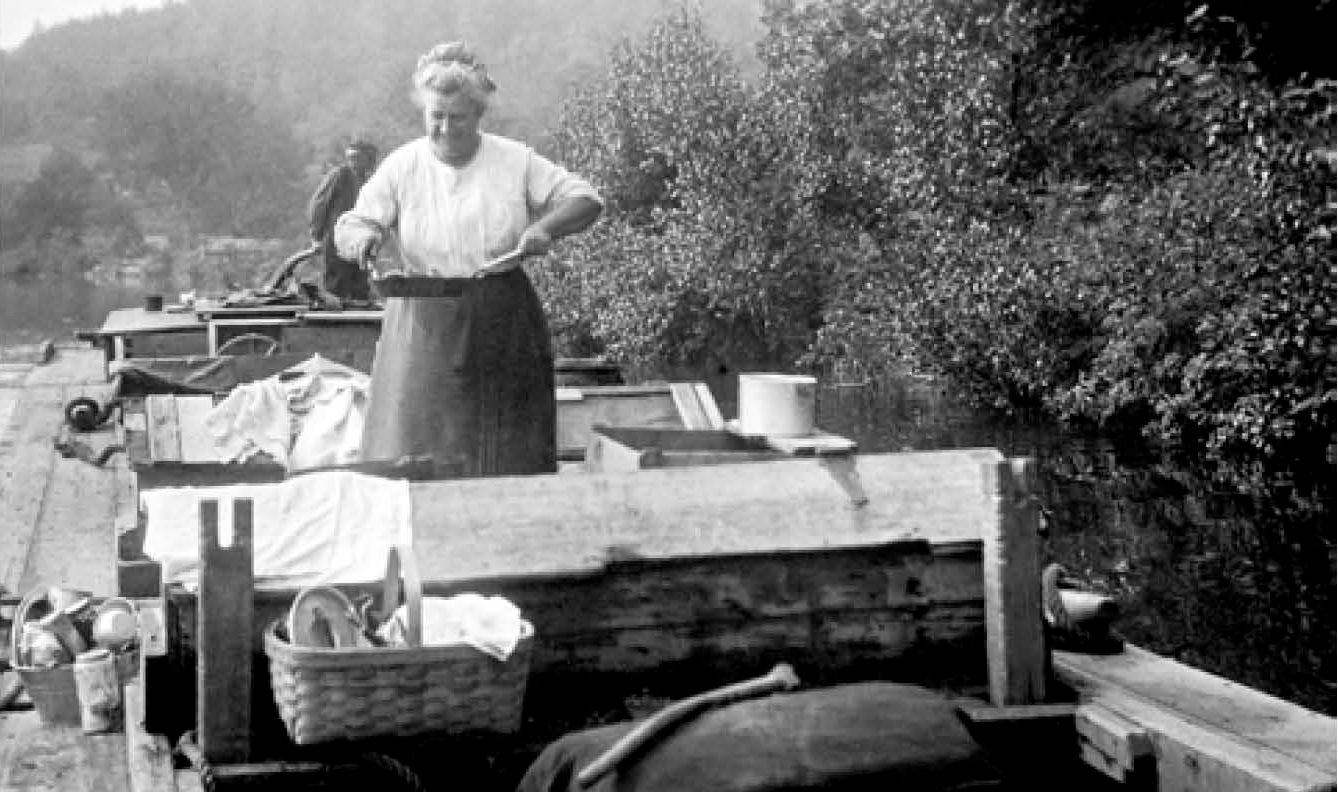 A woman cooks on a barge in the Morris Canal