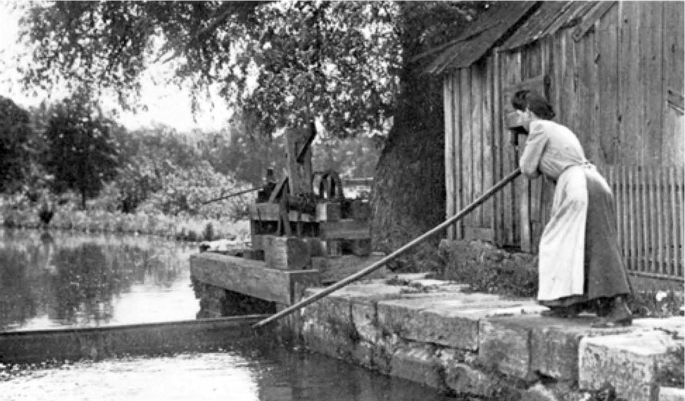 A woman works by the Morris Canal