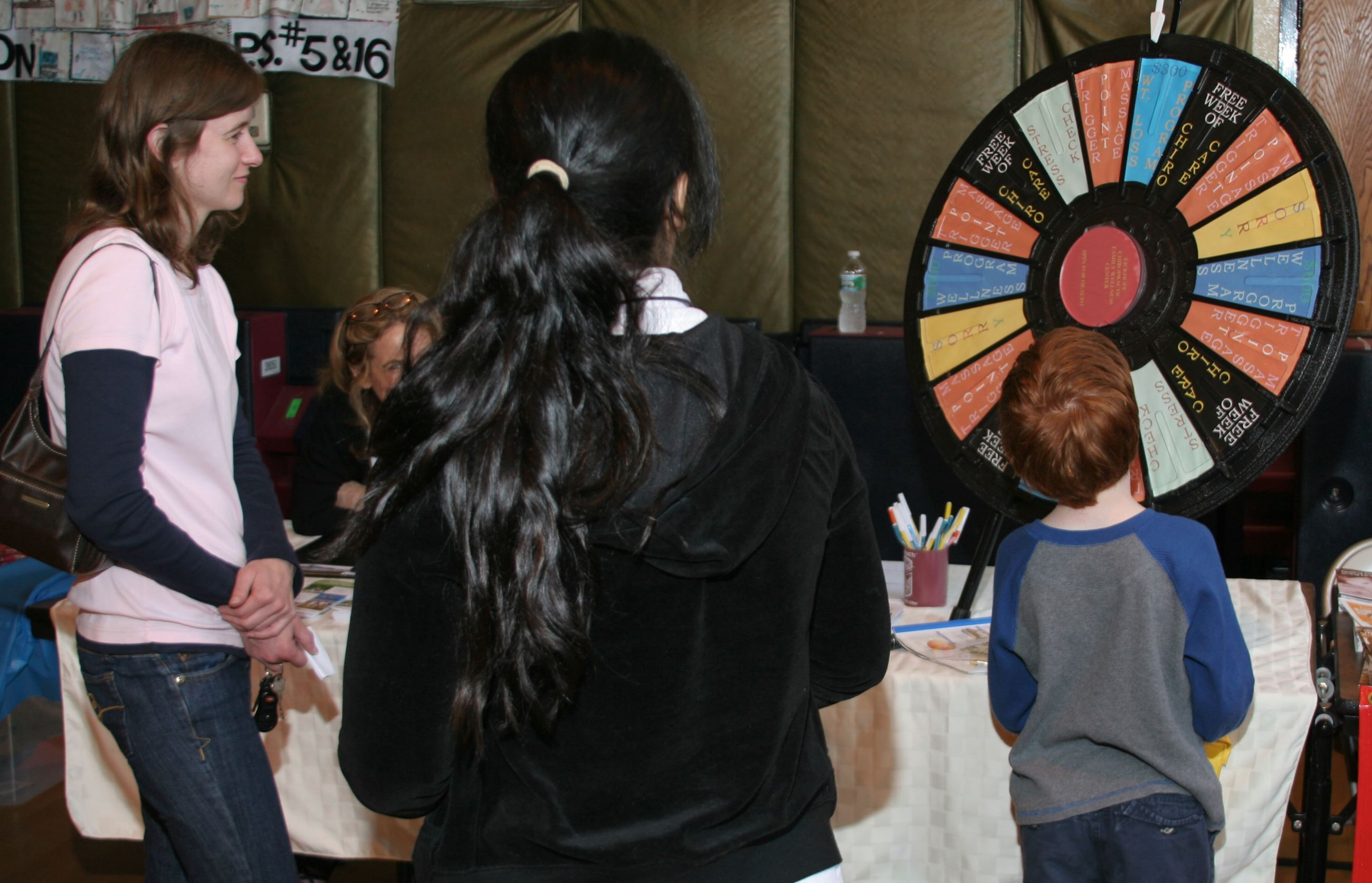 People spin a prize wheel at the Safety Fair